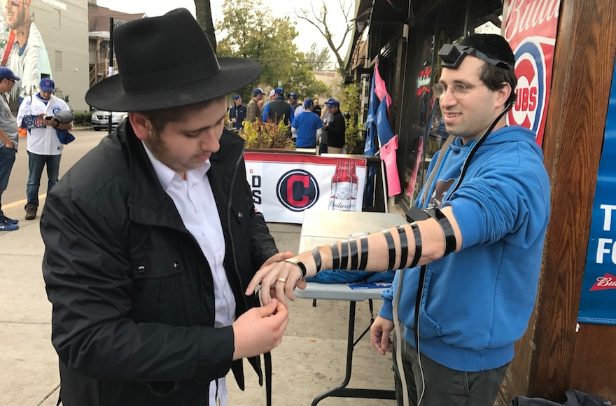 Ben Tolsky laying tefillin outside Wrigley Field. (Molly Tolsky)