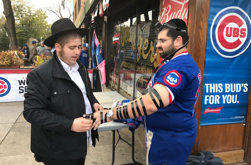 Max Tolsky with a member of the Chabad movement outside Wrigley. (Molly Tolsky)