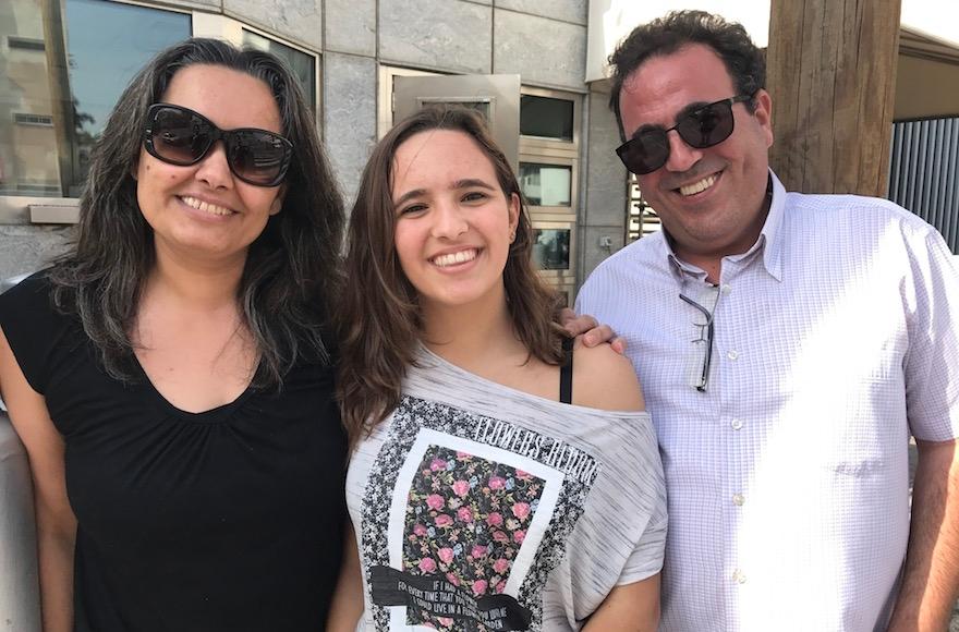Karen Kadosh leaving the U.S. Embassy in Tel Aviv with her parents, Nov. 14, 2016. (Andrew Tobin)