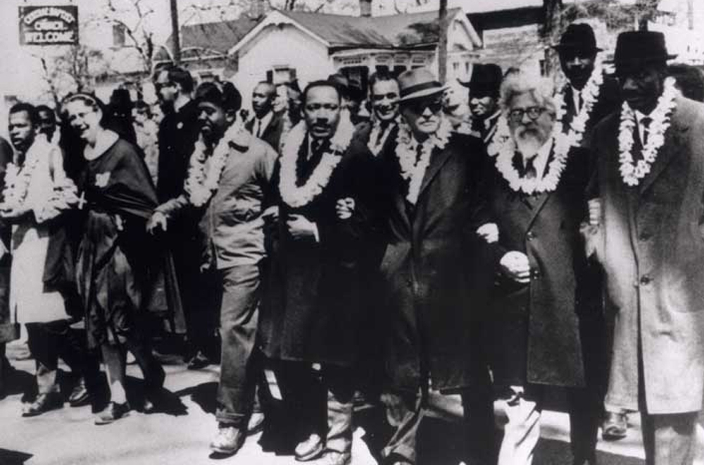 Rabbi Abraham Joshua Heschel, second from right, marching with the Rev. Dr. Martin Luther King, Jr. in the second Selma to Montgomery, Ala. civil rights march on Mar. 21, 1965.