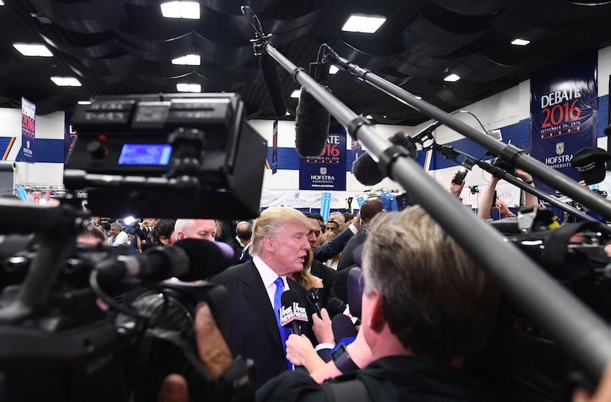 Donald Trump speaking with reporters in the