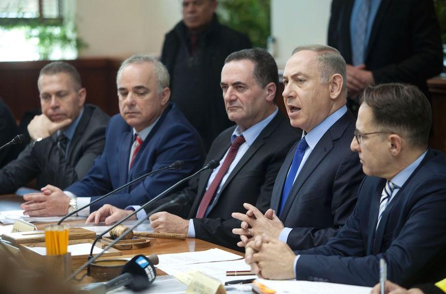 Israeli Prime Minister Benjamin Netanyahu chairing the weekly Cabinet meeting in Jerusalem, Dec. 25, 2016. (Dan Balilty/AFP/Getty Images)