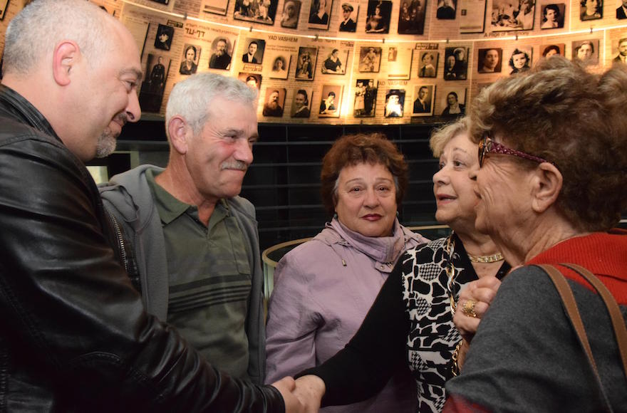 First cousins who thought their entire families died in the Holocaust unite at the Yad Vashem Holocaust museum in Jerusalem, Dec. 13, 2016. (Courtesy of Yad Vashem)
