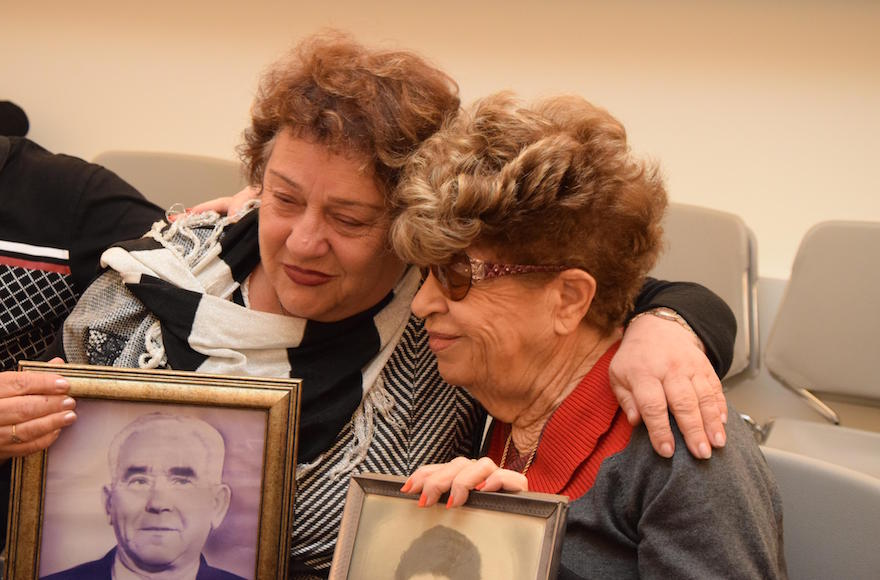 Fania Blakay, left, embracing her cousin Henia Moskowitz after they were united at the Yad Vashem Holocaust museum in Jerusalem, Dec. 13, 2016. (Courtesy of Yad Vashem).
