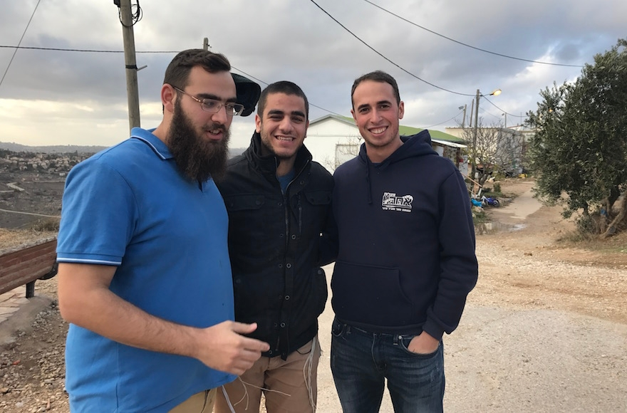 From left to right, Eliav Amir, David Rappaport and Chen Jan visiting Amona, the West Bank, Dec. 13, 2016. (Andrew Tobin)