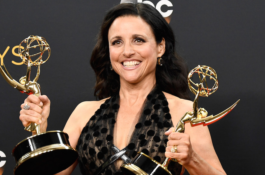 "Julia Louis-Dreyfus, winner of Best Actress in a Comedy Series and Best Comedy Series for ""Veep"", posing in the press room during the 68th Annual Primetime Emmy Awards in Los Angeles, Cali., Sept. 18, 2016. (Frazer Harrison/Getty Images)"
