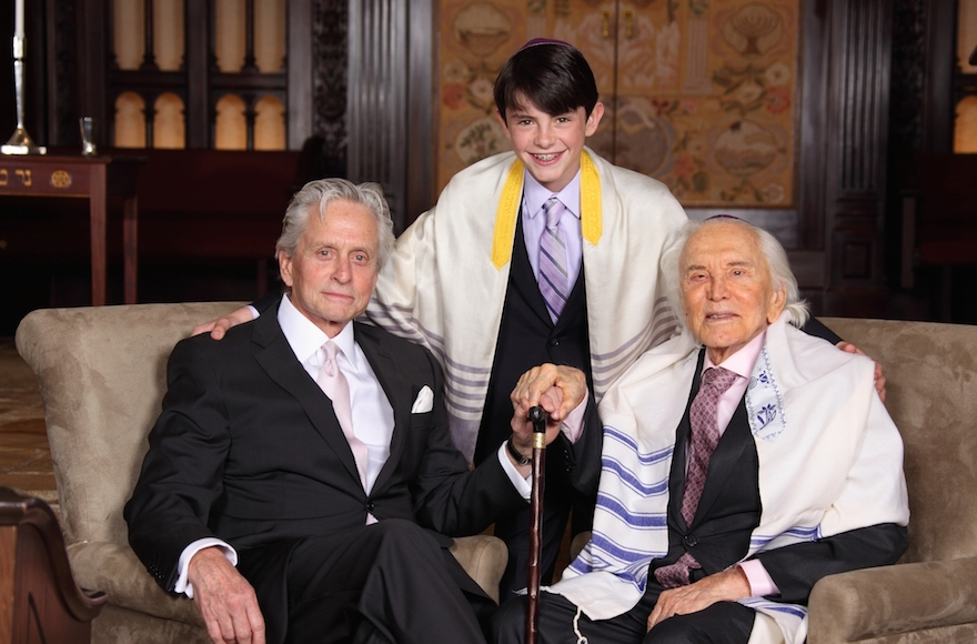 Kirk Douglas, right, with son Michael and grandson Dylan at Dylan's bar mitzvah, May 2014. (Infinity Kornfeld Studios)