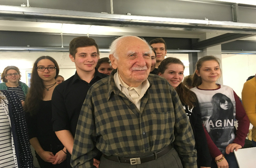 Marcel Tuchman, 95, meets in Berlin with German, Polish and Austrian high school stidents who are studying the history of Nazi-era slave labor.