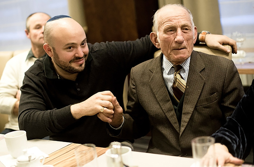 Jozef Jarosz, who saved 14 Jews during the Holocaust, taking a break with Jonny Daniels, left, from filming Jarosz's testimony in Warsaw in November 2016. (Photo courtesy of From the Depths)