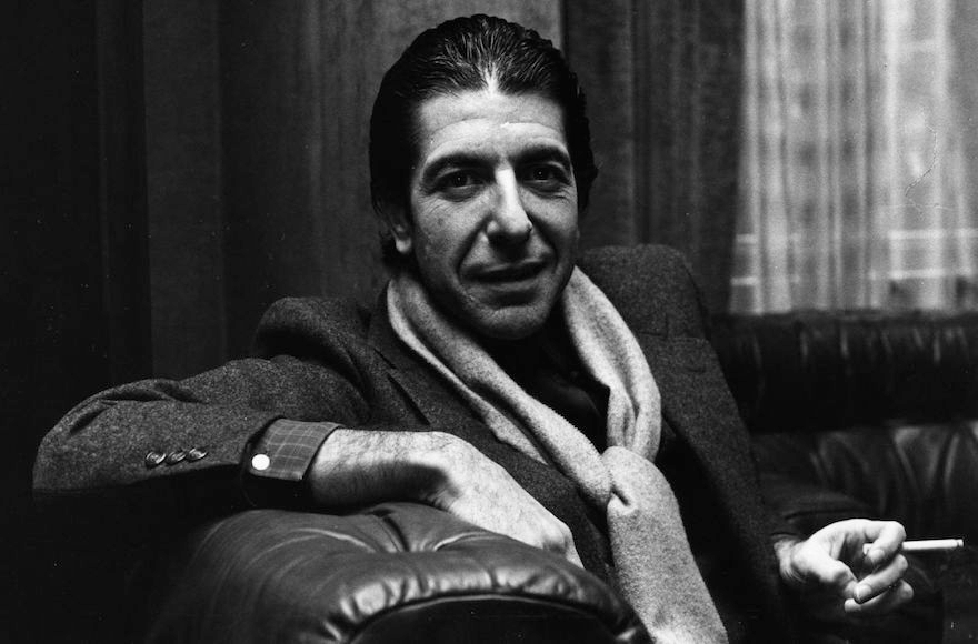 Leonard Cohen sharing a joke and smoking a cigarette in1980. (Evening Standard/Getty Images)
