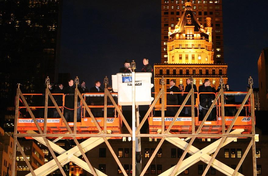 The World's Largest Hanukah Menorah being lighted by then-New York City Mayor Michael R. Bloomberg with Rabbi Shmuel M. Butman, Director of the Lubavitch Youth Organization, in 2013. (PR Newswire)