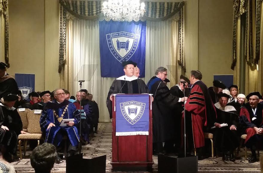Jerusalem Mayor Nir Barkat delivering the convocation after receiving an honorary degree from Yeshiva University at the Waldorf Astoria in New York City, Dec. 11, 2016. (Courtesy of the City of Jerusalem)