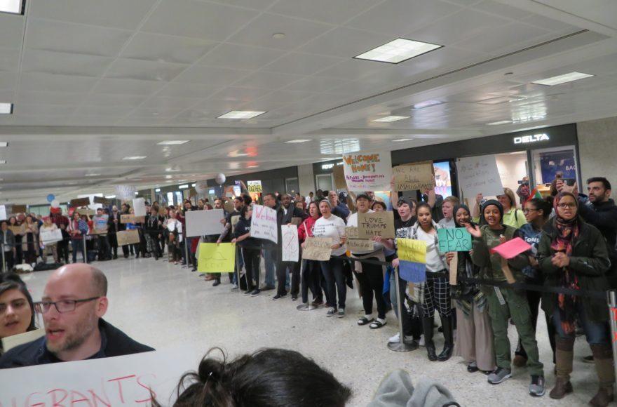 Protesters welcoming Muslim visitors at Dulles International Airport in Virginia, Jan. 28 2017. (Ron Kampeas)