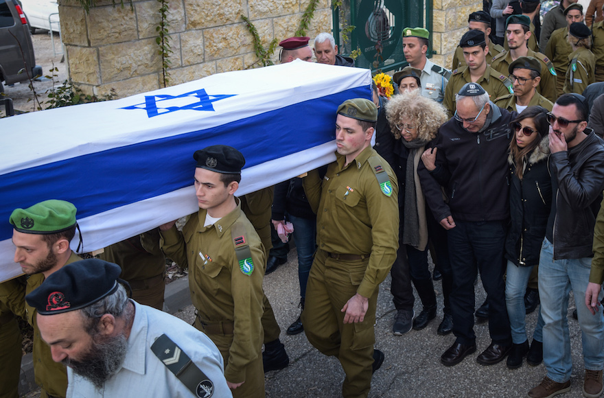 Family and friends mourning at the funeral of IDF Lieutenant Yael Yekutiel, one of the soldiers killed in a truck ramming attack a day earlier in Jerusalem, at the military cemetery in Kiryat Shaul, outside of Tel Aviv, Jan. 9, 2017. (Hadas Parush/Flash90