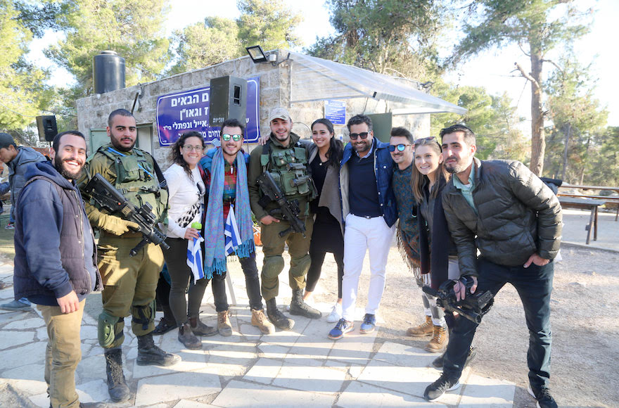 Joseph Waks, fourth from the right, posing with Jewish visitors and soldiers at the Oz Vegaon tent outpost in the West Bank, Jan. 2, 2017. (Courtesy of Avi Hyman Communications)