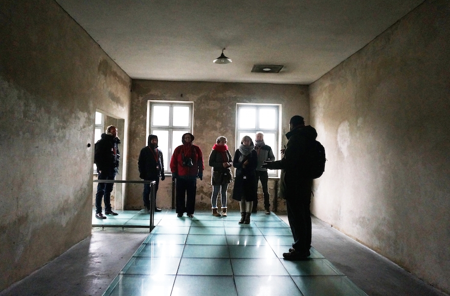 Journalists and a spokesperson of the Auschwitz museum visiting a former disinfection facility, Dec. 1, 2016. (Cnaan Liphshiz)