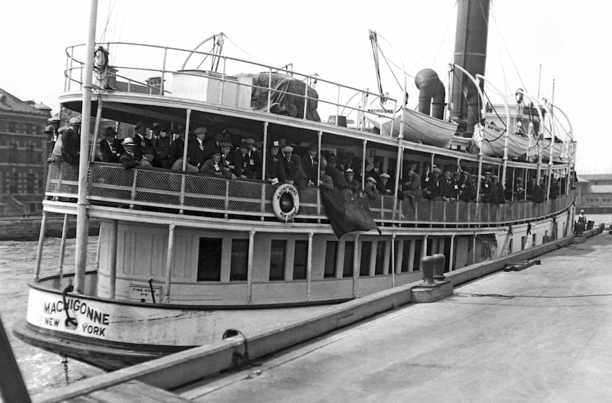 Immigrants arriving at Ellis Island aboard the tender Machigonne in New York, Aug. 21, 1923. (Underwood Archives/Getty Images)