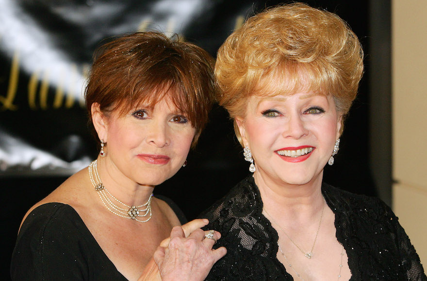 Actress Carrie Fisher, left, and her mother, actress Debbie Reynolds, arriving for Dame Elizabeth Taylor's 75th birthday party at the Ritz-Carlton, Lake Las Vegas, Feb. 27, 2007. (Ethan Miller/Getty Images)
