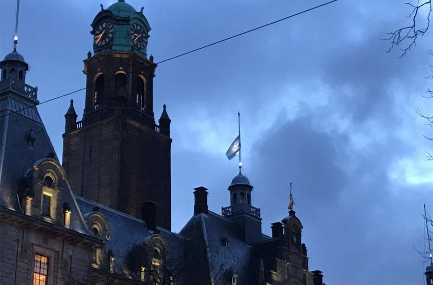 The Israeli flag flying at half-mast atop City Hall in rotterdam, the Netherlands, on Jan. 10, 2017. (Photo courtesy of NIW/David de Leeuw)