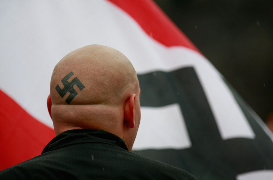 Neo-Nazi protestors organized by the National Socialist Movement demonstrating near where the grand opening ceremonies were held for the Illinois Holocaust Museum & Education Center in Skokie, Ill., April 19, 2009. (Scott Olson/Getty Images)
