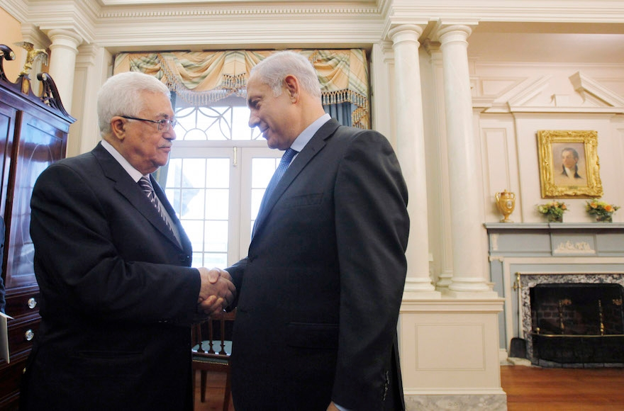 Palestinian Authority Mahmoud Abbas President, left, shaking hands with Israeli Prime Minister Benjamin before holding direct peace talks at the State Department in Washington, D.C, Sept. 2, 2010. (Jason Reed-Pool/Getty Images)
