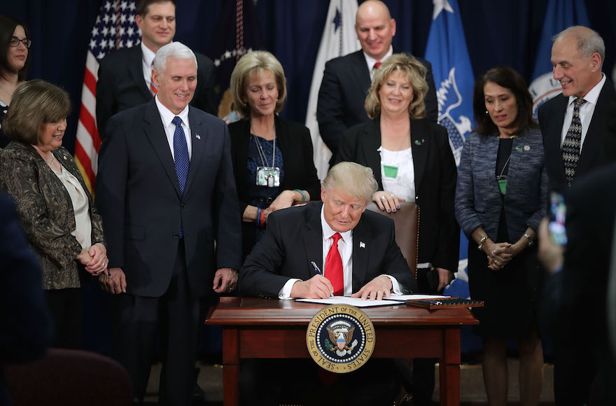 President Donald Trump signing two executive orders during a visit to the Department of Homeland Security, Jan. 25, 2017. (Chip Somodevilla/Getty Images)