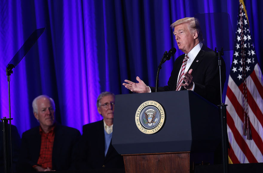 President Donald Trump speaking as Senate Majority Leader Sen. Mitch McConnell, center, and Senate Majority Whip Sen. John Cornyn, left, look on during a luncheon at the Congress of Tomorrow Republican Member Retreat in Philadelphia, Jan. 26, 2017. (Alex Wong/Getty Images)