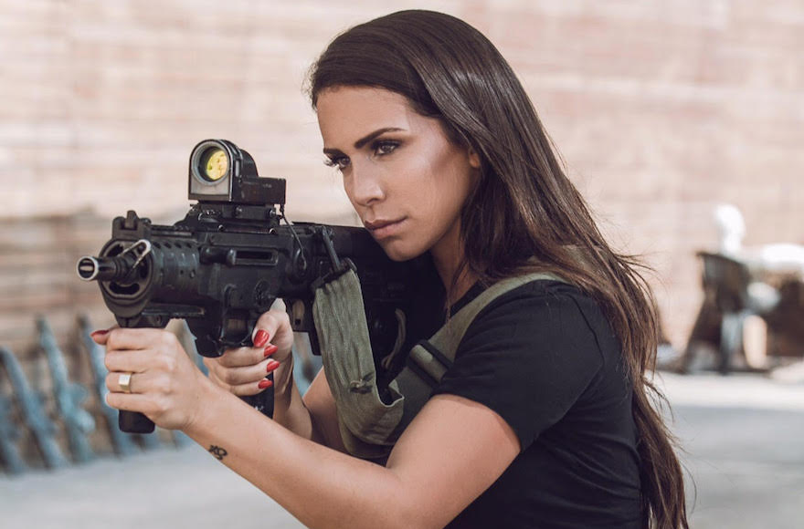 A female Israeli combat soldier proudly models for weapons ...
