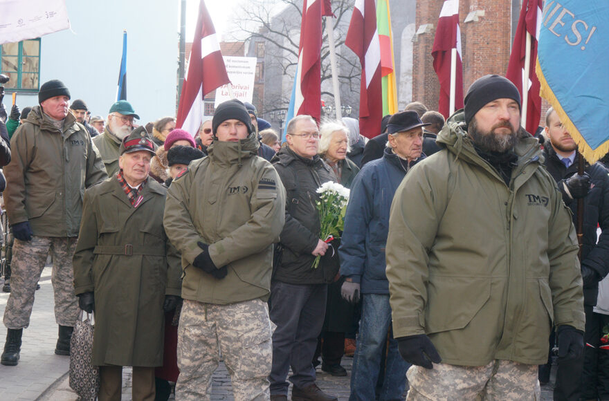 SS veterans and their supporters march in Riga, Latvia on March 16, 2018. (Cnaan Liphshiz)