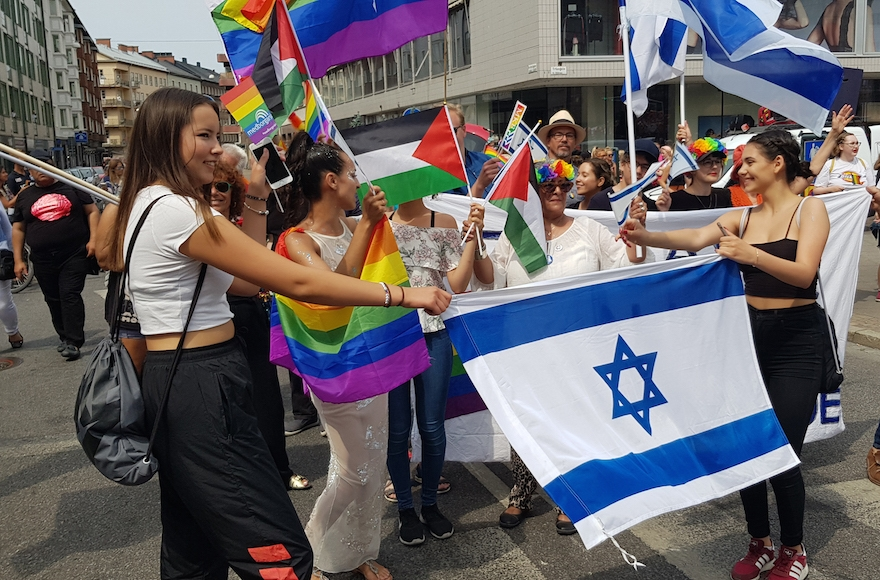 In Sweden, Jews and Muslims united around Israeli flags at a