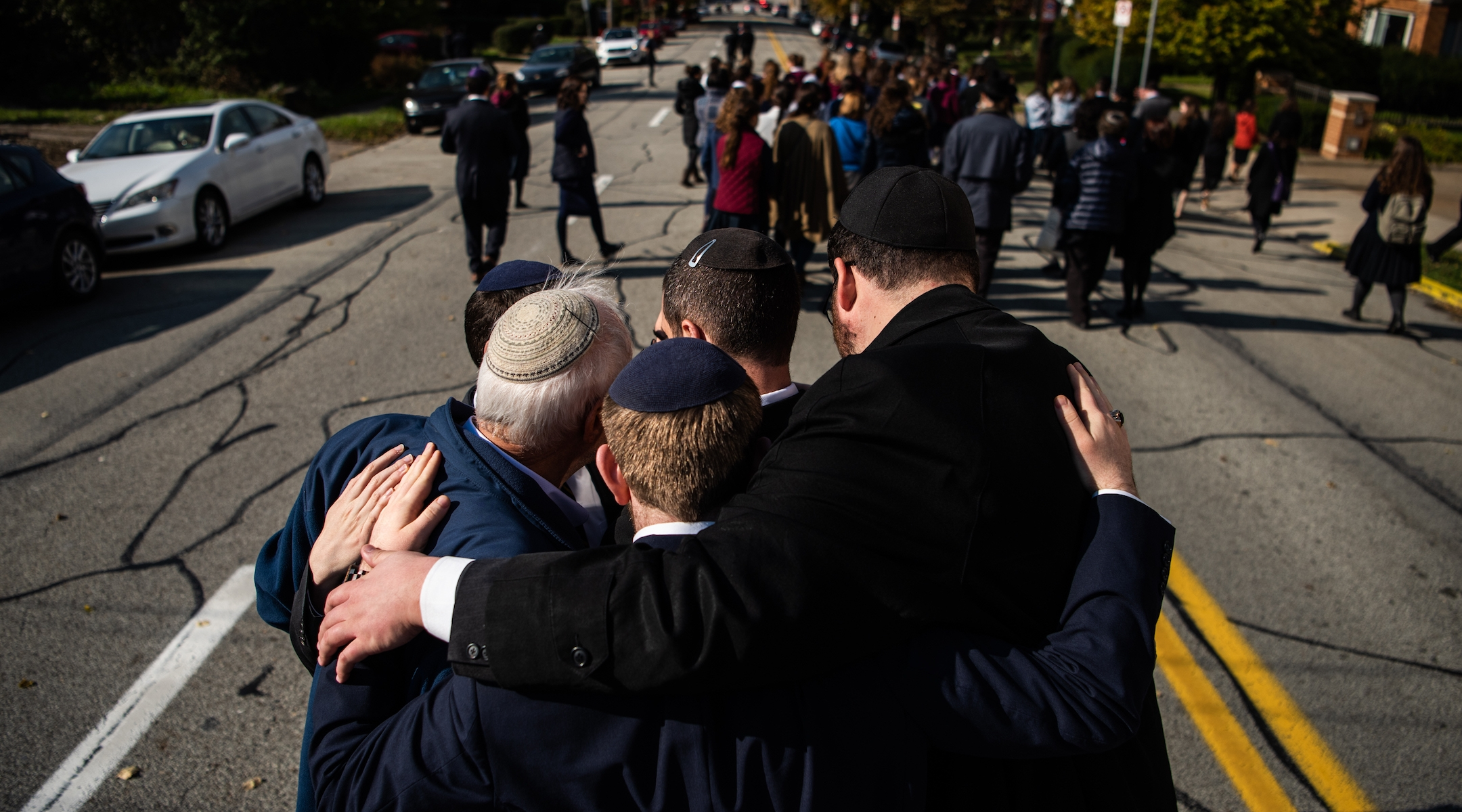 Mourners embrace during a processional outside of Congregation Beth Shalom in Pittsburgh for the funeral of Joyce Fienberg, who was killed at the mass shooting at the Tree of Life synagogue shooting, Oct. 31, 2018. (Salwan Georges/The Washington Post via Getty Images)