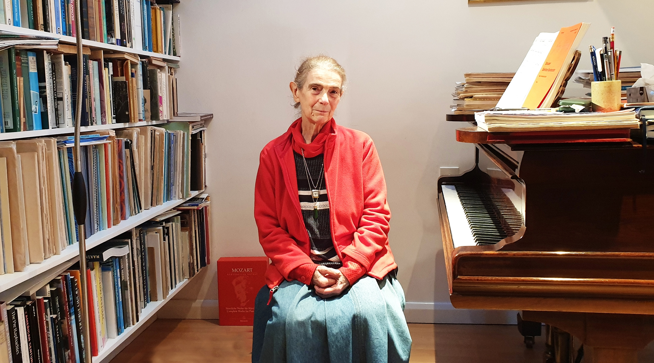 Nelly Ben-Or sitting by one of her two pianos in her London home