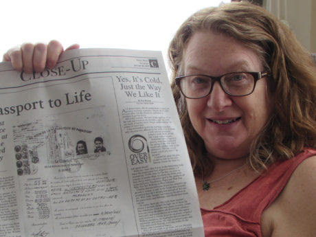 Heidi Fishman holding up an op-ed she wrote about her family's rescue from the Holocaust using a Paraguayan passport. Courtesy of Heidi Fishman