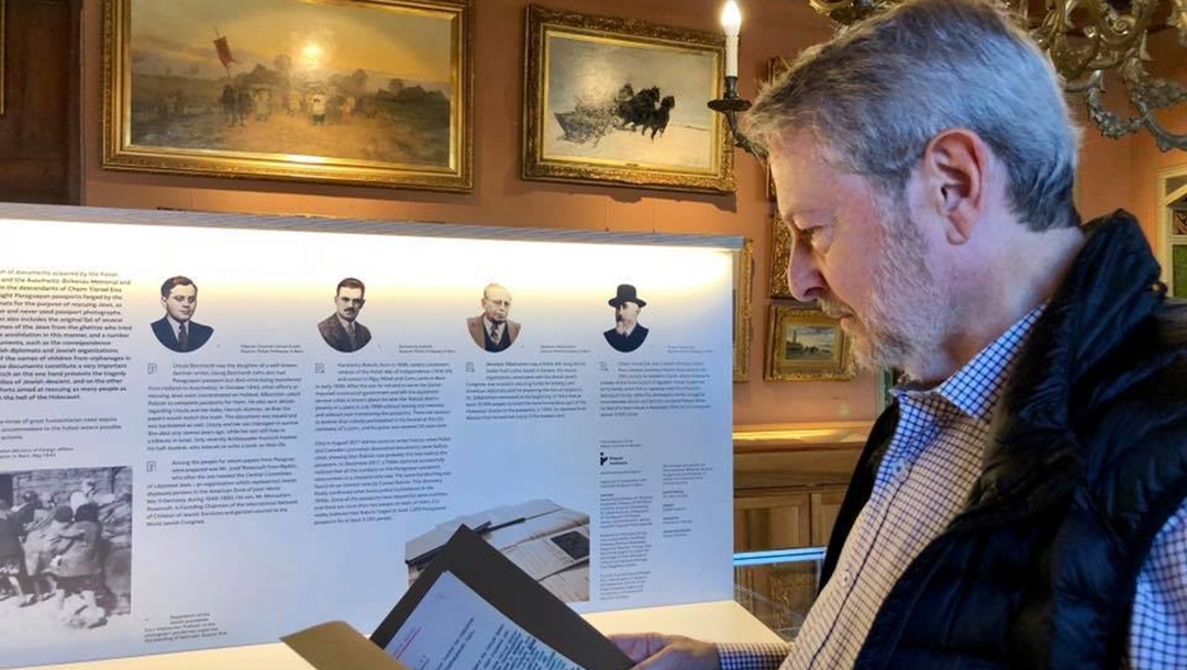 Jeffrey cymbler examining documents tied to the Bernese Group in Switzerland in 2017. Courtesy of Jeffrey Cymbler