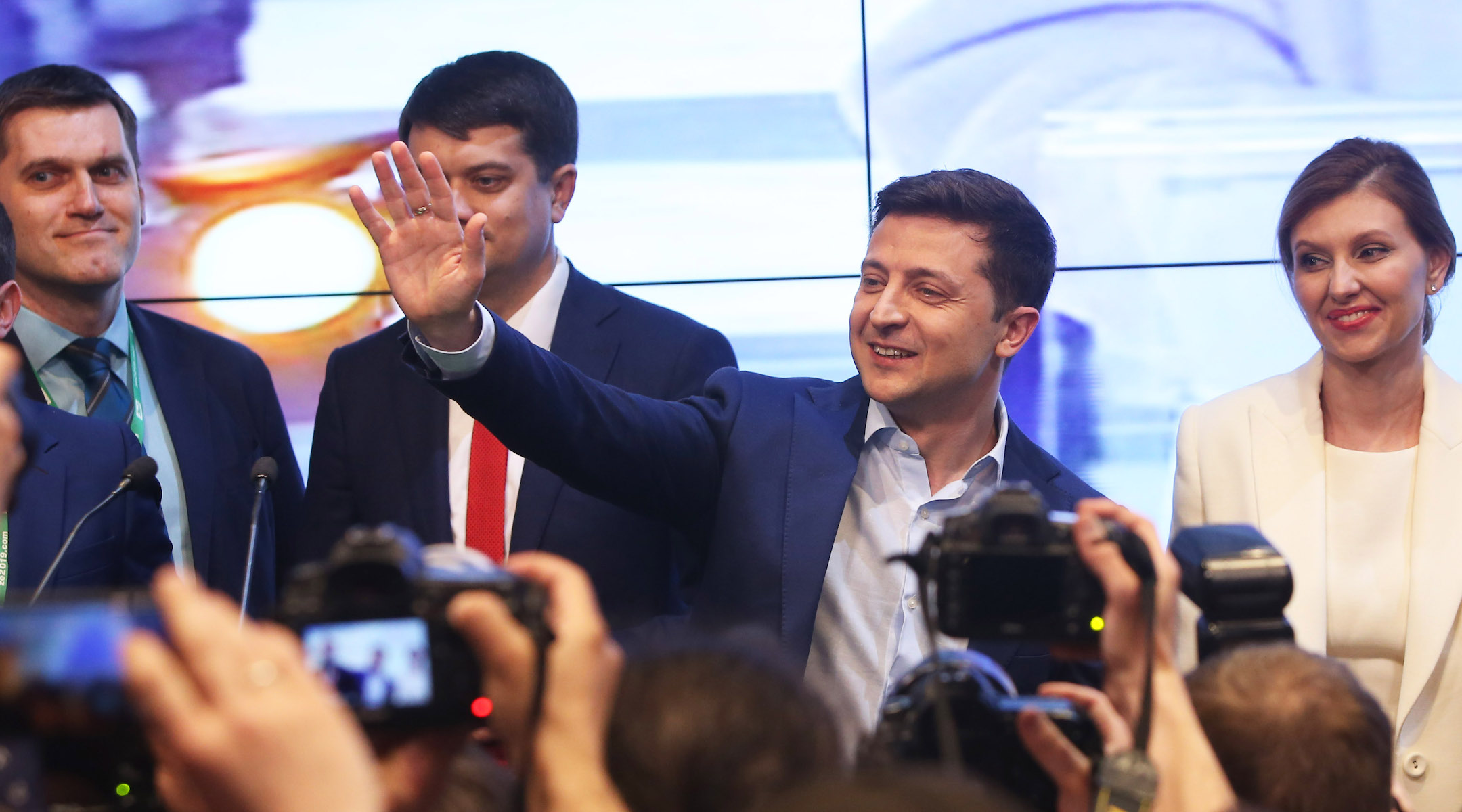 Volodymyr Zelensky, second from right, waves to supporters at his campaign headquarters in Kiev, Ukraine, April 21, 2019. (Xinhua/Sergey/Getty Images)