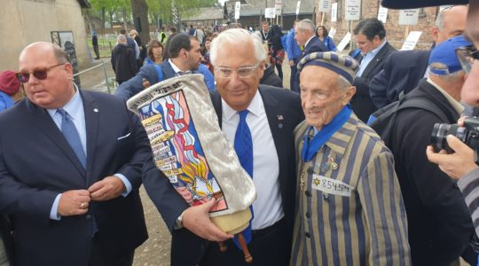 U.S. Ambassador to Israel David Friedman with prominent New Jersey Holocaust survivor Ed Mosberg at the March of the Living at Auschwitz-Birkenau on May 2, 2019. (Cnaan Liphshiz)