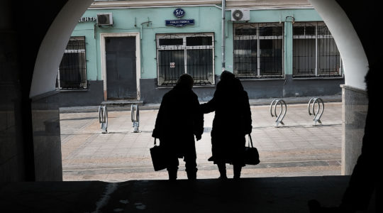 Two women walk along a street in Moscow on March 7, 2017. (Spencer Platt/Getty Images)