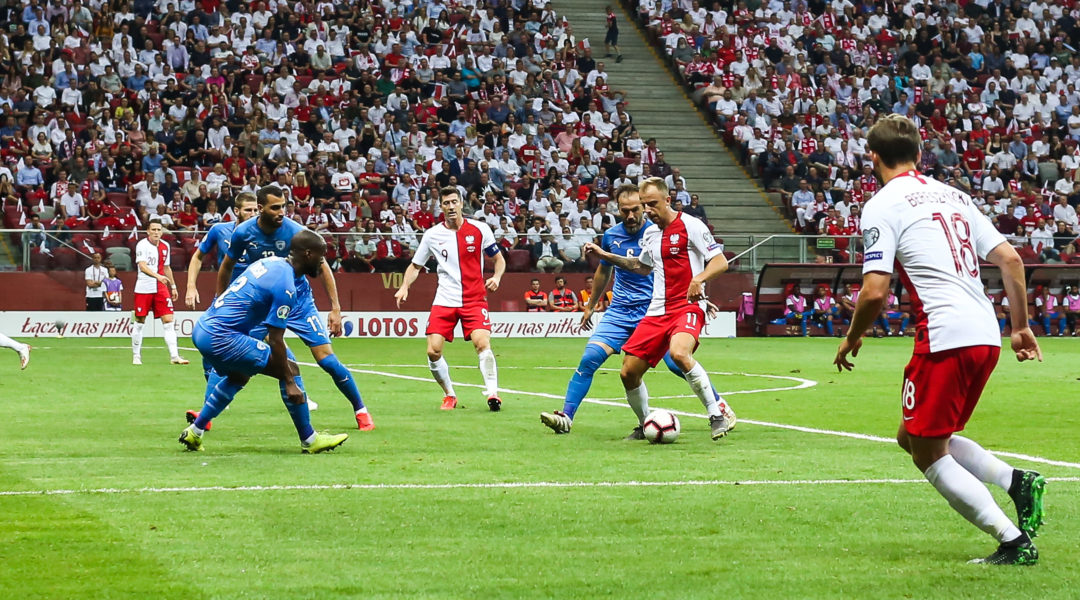 Kamil Grosicki of Poland, Israeli player Bibras Natcho and Poland's forward Robert Lewandowski in action during a match in Poland on June 10, 2019. (Photo by Foto Olimpik/NurPhoto via Getty Images)