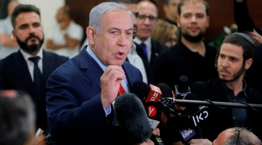 Israeli Prime Minister Benjamin Netanyahu talks to the press following a vote on a bill to dissolve the Israeli parliament in Jerusalem, May 29, 2019. (Menahem Kahana/AFP/Getty Images)