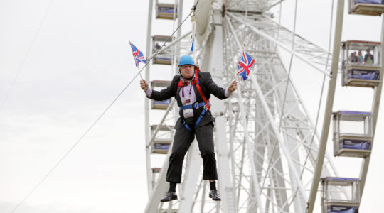 British Prime Minister-elect Boris Johnson waiting to glide on a zip line onto the Olympic Park in London, the United Kingdom, on August 1, 2012. (Barcroft Media / Barcroft Media via Getty Images)