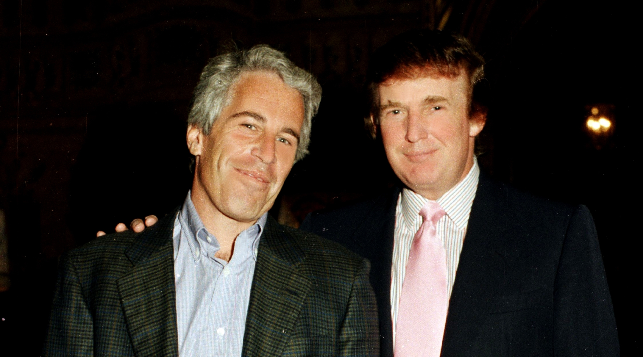 Jeffrey Epstein with Donald Trump at Trump's Mar-a-Lago estate in Palm Beach, Fla., in 1997. (Davidoff Studios/Getty Images)