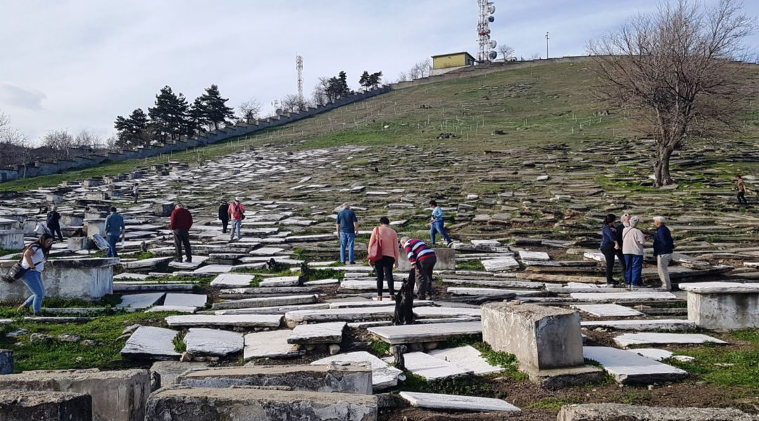 Visitors touring the Jewish cemetery of Bitola, Macedonia in 2018. (Wikimedia Commons/Yael Unna)