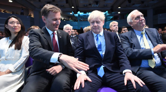 Foreign Secretary Jeremy Hunt, left, extending a hand to congratulate Boris Johnson for being elected as the new leader of the Conservative Party and British Prime Minister in London, the United Kingdom, on July 23, 2019 (Stefan Rousseau - WPA Pool/Getty Images)