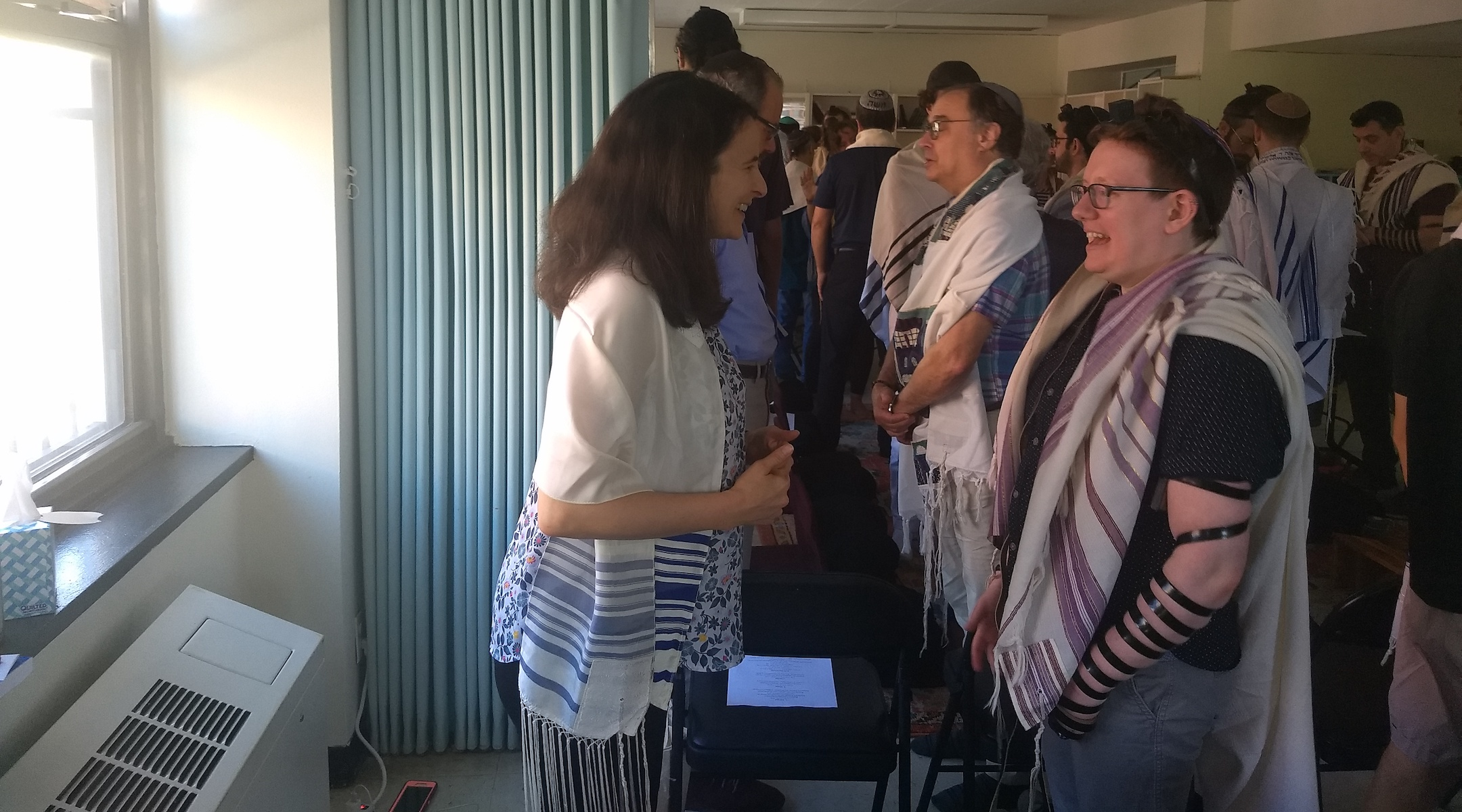 "Sarah Hurwitz (left), a former speechwriter for First Lady Michelle Obama, does a ""gazing exercise"" with rabbinical student Lily Solochek at Romemu Yeshiva in New York, N.Y. on July 16, 2019. (Ben Sales)"