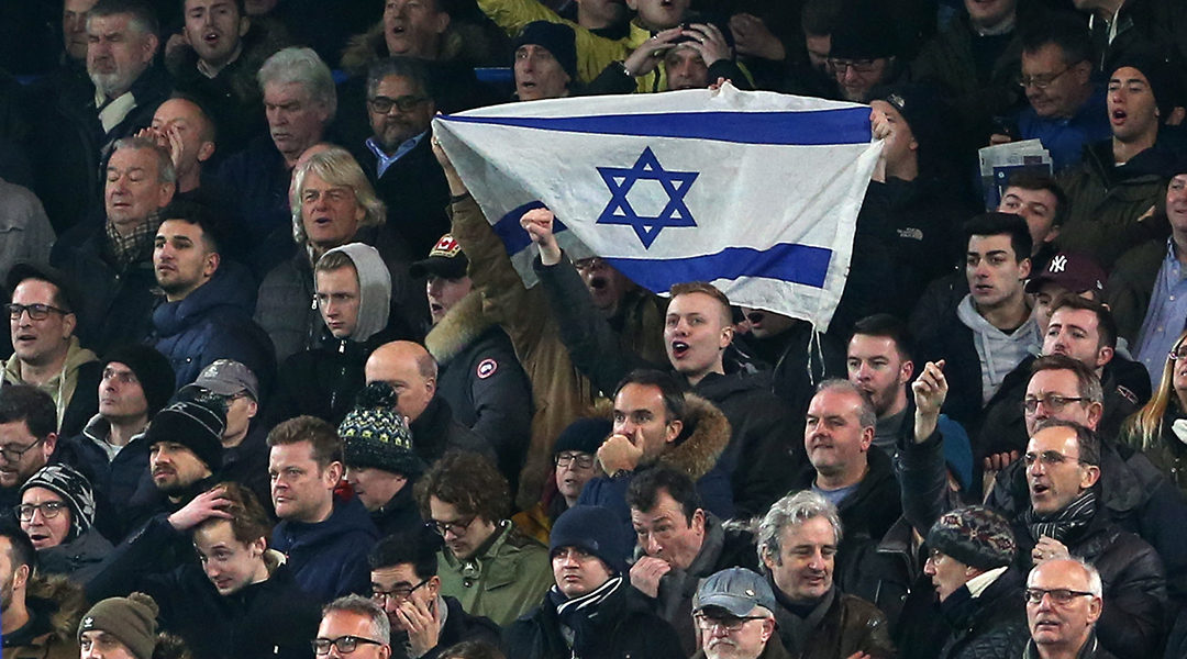 Soccer supporters hold an Israeli flag during a match between Chelsea and Tottenham Hotspur at in London, the United Kingdom on Jan. 24, 2019. (Charlotte Wilson/Offside/Getty Images)