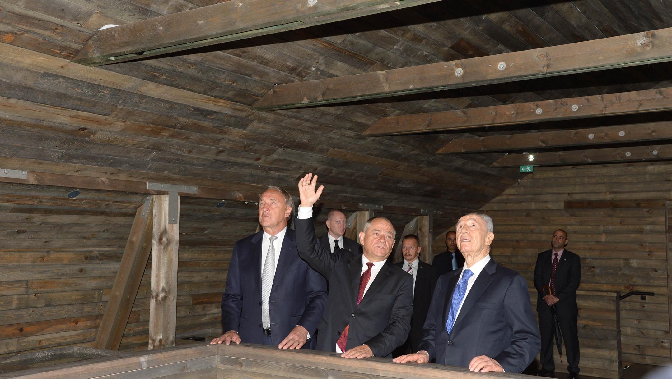 Israeli President Shimon Peres, right, and Latvia President Andris Berzinns attend the opening of the Zanis Lipke Memorial Museum in Riga, Latvia on July 30, 2013 . (Moshe Milner/GPO via Getty Images)