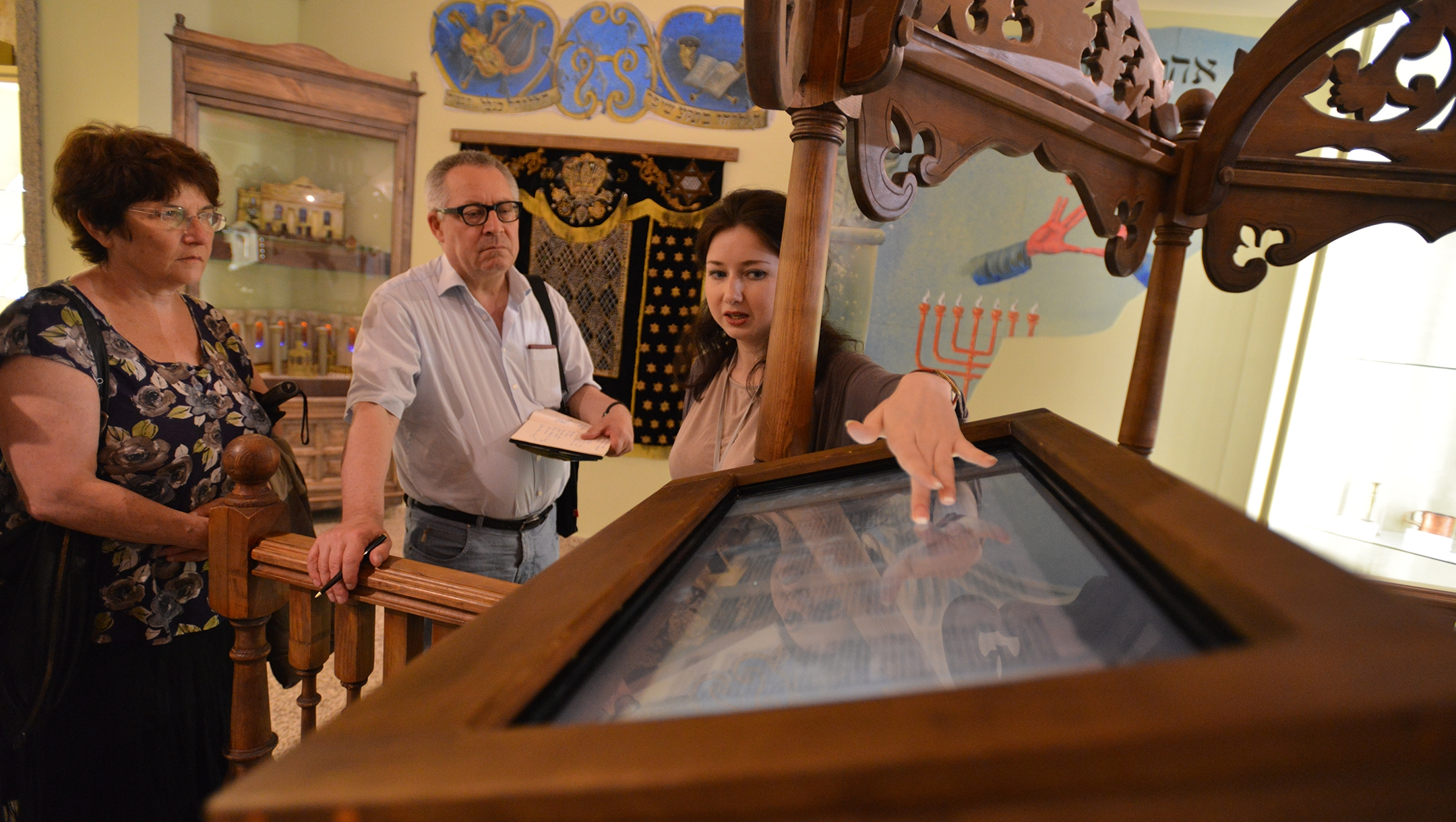 A guide explaining to visitor about the Holocaust at the Tkuma museum in Denpro, Ukraine on May 20, 2014. (Cnaan Liphshiz)