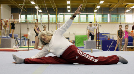 Agnes Keleti performs a split in front of Hungarian young gymnasts Budapest on January 16, 2016. (Peter Kohalmi/AFP/Getty Images)