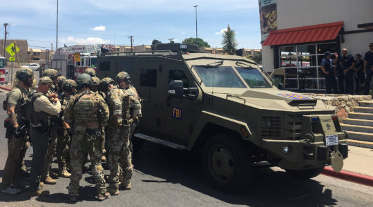 Armed policemen gather next to an FBI armored vehicle next to the Cielo Vista Mall in El Paso on August 3, 2019. The shooter is being investigated as a domestic terrorist. (Joel Angel Juarez/AFP/Getty Images)