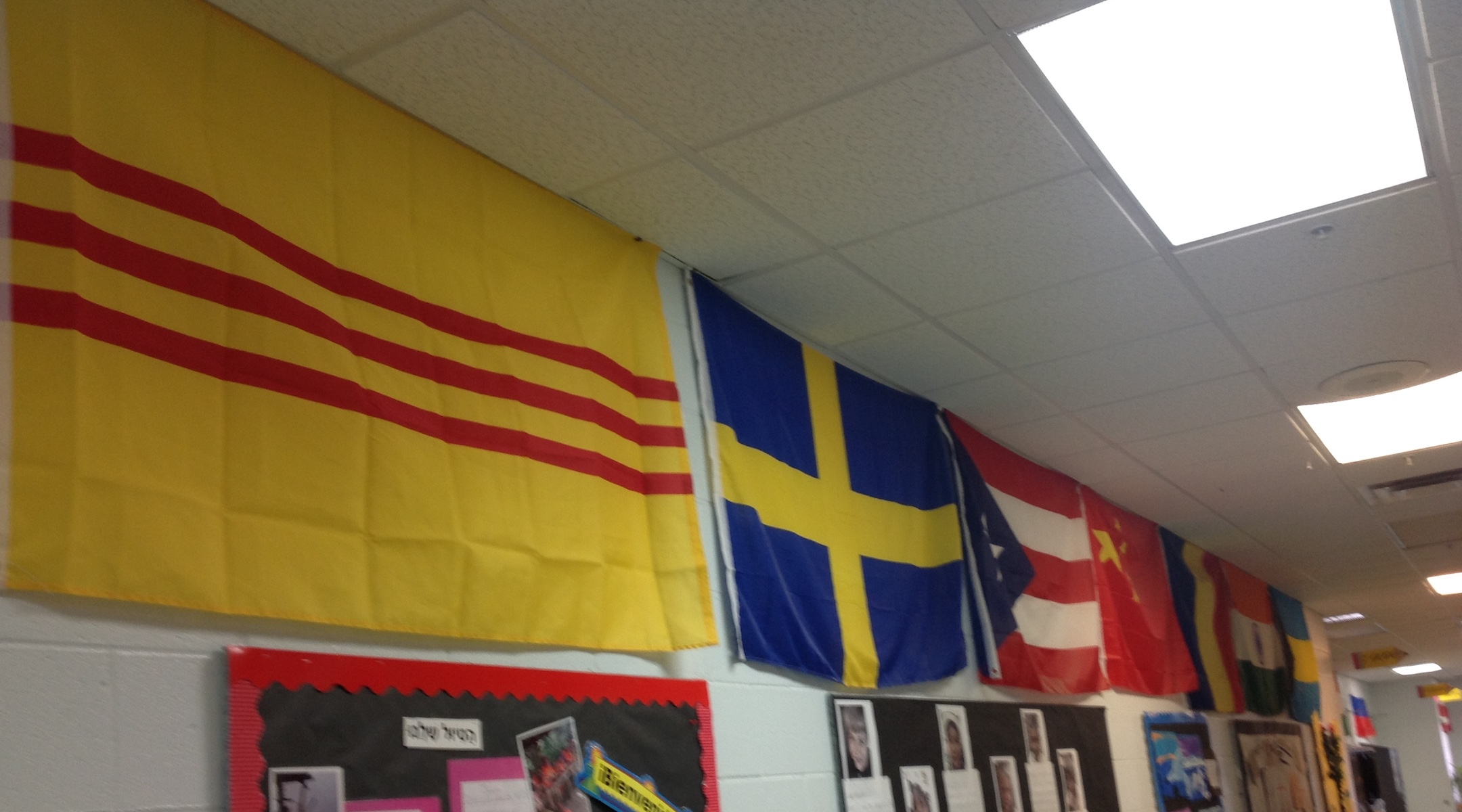 The school has a hallway of flags representing the 40 countries its students' families hail from. (Ben Sales)